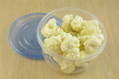 Cauliflower florets in storage container. Food preparation of cauliflower florets in plastic storage container Royalty Free Stock Photos