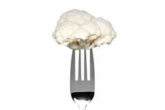 Cauliflower on a fork isolated on white Royalty Free Stock Photos