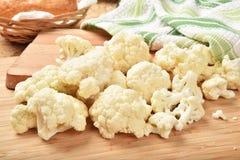 Cauliflower. Fresh organic cauliflower on a cutting board Stock Photos