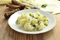 Cauliflower with garlic and parsley in lemon sauce Stock Images