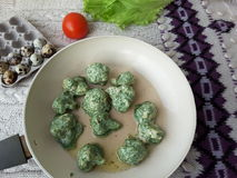 Cauliflower in green nettles tempura, fritters cooking vegetarian food with nettles. Lemon and tomato royalty free stock images