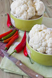 Cauliflower and hot red pepper. In a bowl on the table Royalty Free Stock Photo