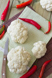 Cauliflower and hot red pepper. On the table Stock Photos