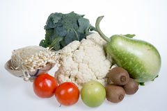 Cauliflower,kiwi,tomatoes,jujubes,broccoli,golden needle mushroom and bottle gourd Royalty Free Stock Photography