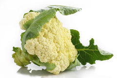 Cauliflower with leaves on white Royalty Free Stock Photography