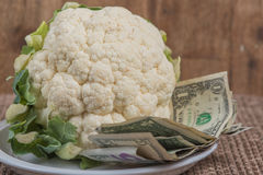 Cauliflower with money. Cauliflower shortage has made cauliflower become expensive Stock Photos