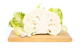 Cauliflower and nutmeg  on a chopping board Stock Image