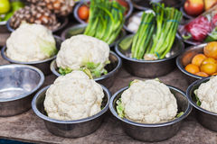 Cauliflower and other vegetables on sale. Bowls with cauliflower and other vegetables on farmer's stall Stock Photo