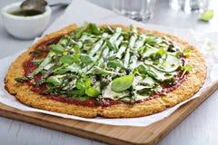 Cauliflower pizza with zucchini and asparagus Stock Photos