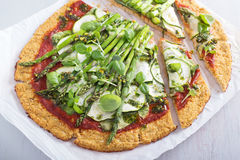Cauliflower pizza with zucchini and asparagus Royalty Free Stock Photography