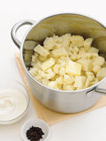 Cauliflower and potato in a pot with butter. Ready to be mashed. With yogourt or sour cream and peppercorns royalty free stock image
