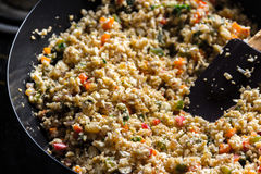 Cauliflower Rice. In a skillet -  cooking close up image Stock Image