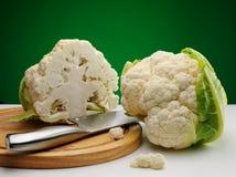 Cauliflower. Ripe cauliflower on the table over green background Stock Image