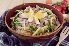 Cauliflower salad with potatoes, hard cheese, eggs, red onion and radish Stock Images