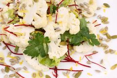 Cauliflower salad with seeds and parsley. Royalty Free Stock Photos