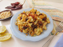 Cauliflower with sausages. Stock Photos