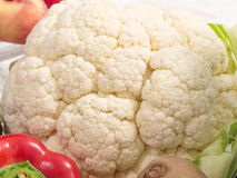 Cauliflower and some fresh vegetables. A cauliflower and some fresh vegetables stock photos