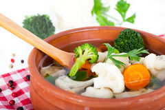 Cauliflower soup in clay bowl Stock Photos