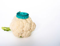Cauliflower. With tape measure concept of losing weight, to be good healthy in 2017 Stock Photos