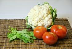Cauliflower, tomato, basil Stock Photography