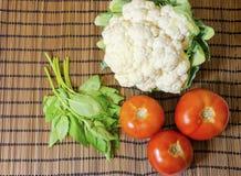 Cauliflower, tomato, basil Royalty Free Stock Photography