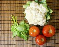 Cauliflower, tomato, basil Royalty Free Stock Images