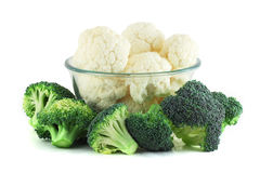 Cauliflower in transparent bowl and broccoli. On white Royalty Free Stock Image