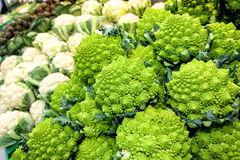 Cauliflower vegetables. Broccoli romanesco and artichokes. Vegetables. Some cauliflower, broccoli romanesco (a kind of cauliflower) and artchokes in the distance Stock Photo