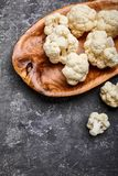 Cauliflower on wooden plate and grey concrete stock photos
