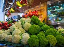 Cauliflowers on market. Choice of cauliflowers on market's counter Stock Image