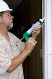 Caulking doors Royalty Free Stock Photo