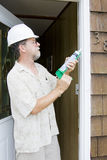 Caulking doors Royalty Free Stock Photography