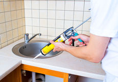 Caulking gun putting silicone sealant Royalty Free Stock Image