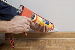 Caulking silicone on wooden batten. Royalty Free Stock Photography