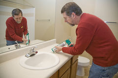Caulking sink Royalty Free Stock Image