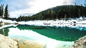 Caumasee Lake Swiss Water Timelapse 4k. Timelapse of a lake, partially covered with snow. 4k footage stock video