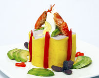 Causa, a Peruvian dish made of mashed potato mixed with aji (hot pepper) and lime and filled with vegetables (corn, peas, carrots) Stock Photos