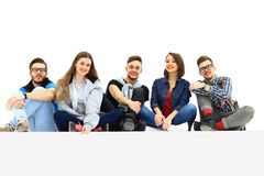 Causal group of people sitting on the floor Stock Images