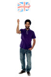 Causal guy waving United Kingdom flag Royalty Free Stock Images