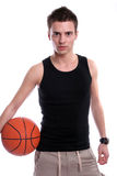 Causal man holding basketball ball Stock Image