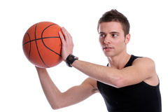 Causal man holding basketball ball. Isolated on white background royalty free stock images