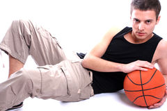 Causal man holding basketball ball. Isolated on white background royalty free stock photos
