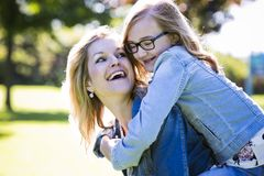 Causal mother and daughter in the park Stock Photography