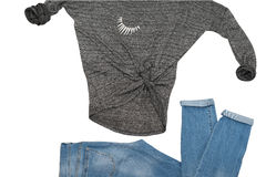 Causal wear blue jeans gray sweater  accessory around the neck Royalty Free Stock Image