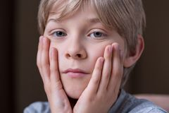 Cause of boy's sadness Stock Photos