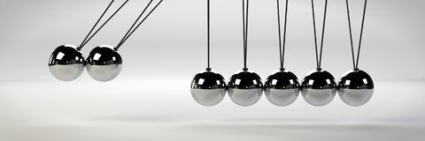 Cause and effect concept, metal Newton`s cradle with two balls in motion on a white background 3d illustration banner. Close up of an unusual Newton`s cradle Stock Photos
