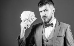 Cause money is work. Bearded man holding cash money. Business startup loan. Rich businessman with us dollars banknotes. Currency broker with bundle of money royalty free stock image
