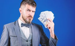 Cause money is work. Bearded man holding cash money. Business startup loan. Rich businessman with us dollars banknotes. Currency broker with bundle of money royalty free stock photo