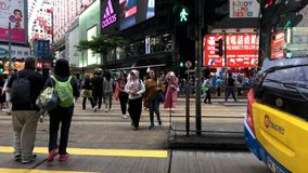 Pedestrians go through the underground tunnel at rush hour in central district. Causeway Bay, Hong Kong  - April 01, 2017 : Pedestrians crossing the street in stock footage