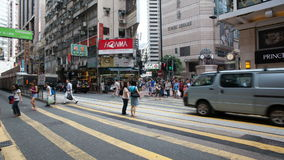 CAUSEWAY BAY, HONG KONG - MAY 31, 2014: Time lapse of pedestrians and auto traffic crossing busy intersection at Times Square stock video footage